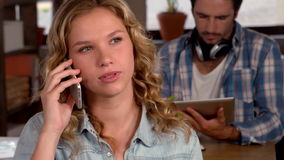 Casual business team on electronic devices. In slow motion stock video footage