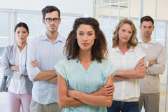 Casual business team frowning at camera with arms crossed Royalty Free Stock Photos