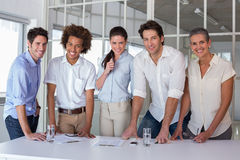 Casual business team having a meeting smiling at camera Stock Images