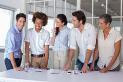 Casual business team having a meeting standing Royalty Free Stock Images