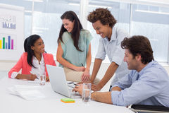Casual business team having a meeting using laptop Royalty Free Stock Photography