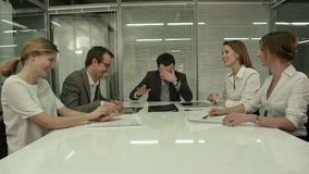 Casual business team laughing during meeting in stock video
