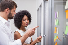 Casual business team looking at sticky notes royalty free stock photos