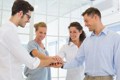 Casual business team putting their hands together Stock Photo