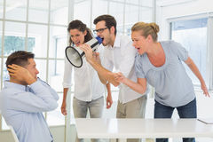Casual business team shouting at a colleague Stock Photography