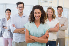 Casual business team smiling at camera with arms crossed Royalty Free Stock Photos