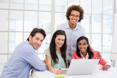 Casual business team smiling at camera during meeting Royalty Free Stock Image