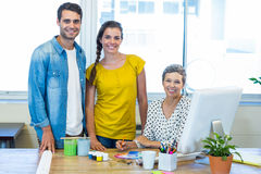 Casual business team smiling at camera during meeting Stock Images