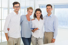 Casual business team smiling at camera Stock Images