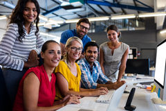 Casual business team smiling at camera Royalty Free Stock Photo