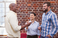 Casual business team talking and laughing Royalty Free Stock Photography