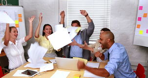 Casual business team throwing papers in the air stock footage