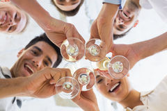 Casual business team toasting with champagne Stock Photos