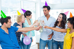 Casual business team toasting with champagne Royalty Free Stock Images