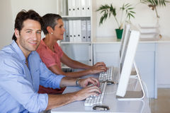 Casual business team working at desk using computers Royalty Free Stock Photo