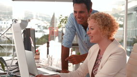Casual business team working together with computer stock footage
