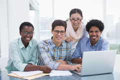 Casual business team working together at desk Royalty Free Stock Photos