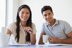 Casual business team working together at desk Stock Image