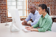Casual business team working together at desk Royalty Free Stock Image