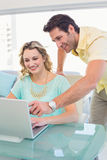 Casual business team working together with laptop Royalty Free Stock Photography