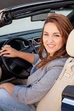 Casual business woman. Smiling on a car Royalty Free Stock Images