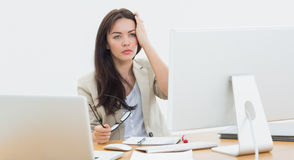 Casual business woman in front of computer at office Stock Images