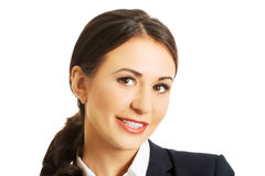 Casual business woman looking happy and smiling Royalty Free Stock Photos