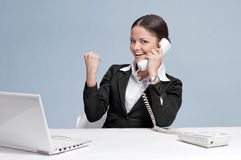 Casual business woman in office talking by phone Stock Image