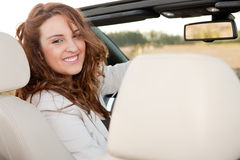 Casual business woman smiling on a car. Successful and beuatiful business woman smiling on a car Stock Photography