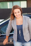 Casual business woman smiling on a car. Successful and beautiful business woman smiling on a car Stock Images
