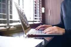 The Casual business woman works online on laptop which hand on k royalty free stock photography