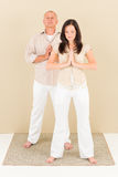 Casual business yoga pose businesspeople standing Stock Photos