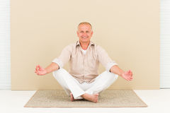 Casual business yoga smiling senior man meditate Stock Image