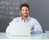 Casual businessman with computer stock photos