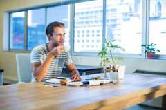 Casual businessman drinking coffee at his desk Royalty Free Stock Photo