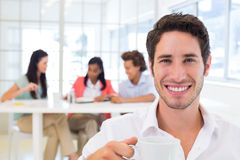 Casual businessman drinking hot beverage Stock Photos