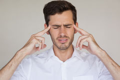 Casual businessman getting a headache Royalty Free Stock Image