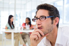 Casual businessman with glasses concentrating Royalty Free Stock Image