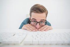 Casual businessman hiding at his desk Stock Photos