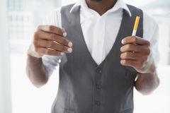 Casual businessman holding cigarettes Royalty Free Stock Photo