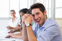 Casual businessman laughing during meeting Royalty Free Stock Photo