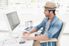 Casual businessman listening music and using computer Stock Photo