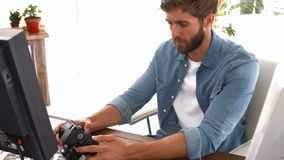 Casual businessman looking at picture on camera stock video footage