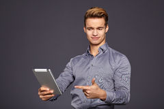 Casual Businessman Looking at a tablet, Stock Photos