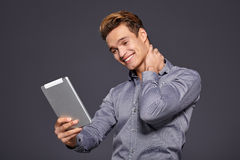 Casual Businessman Looking at a tablet, Royalty Free Stock Photo