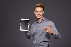 Casual Businessman Looking at a tablet, Royalty Free Stock Image