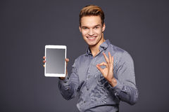 Casual Businessman Looking at a tablet, Stock Photography