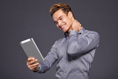 Casual Businessman Looking at a tablet, Royalty Free Stock Photography
