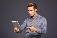 Casual Businessman Looking at a tablet, Stock Photo