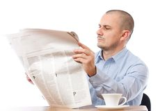 Casual businessman with newspaper Royalty Free Stock Photo
